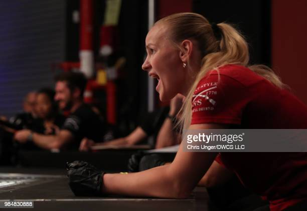 Valentina Shevchenko yells instructions to her sister Antonina as she fights Jaimee Nievera in a women's flyweight bout during Dana White's Tuesday...