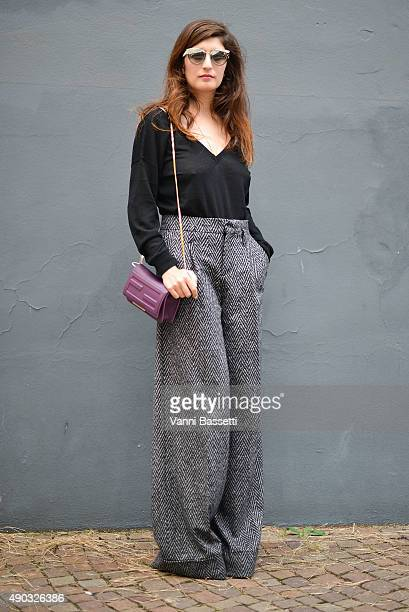 Valentina Siragusa poses wearing Jil Sander top and Pants and Fendi bag before the MSGM show during the Milan Fashion Week Spring/Summer 16 on...
