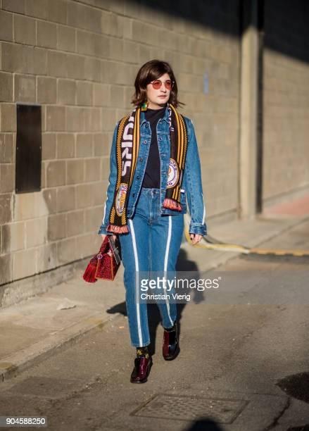 Valentina Siragusa wearing football scarf denim jacket denim jeans is seen outside Diesel during Milan Men's Fashion Week Fall/Winter 2018/19 on...