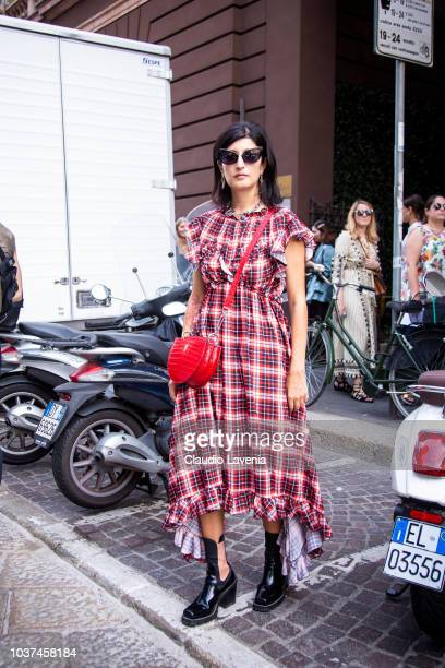 Valentina Siragusa wearing MSGM checked dress red Bally bag black heeled boots and Max Mara sunglasses is seen before the Sportmax show during Milan...