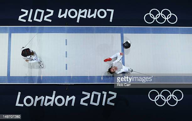 Valentina Vezzali of Italy celebrates as she wins gold during her contest with Larisa Korobeynikova of Russia in the Women's Foil Team Fencing gold...