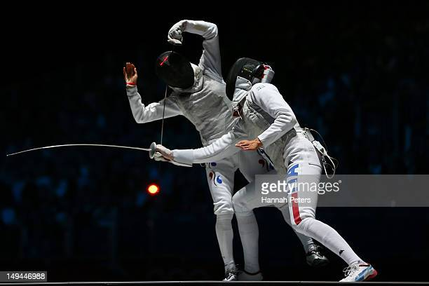 Valentina Vezzali of Italy competes against Hyun Hee Nam of Korea during their Women's Foil Individual Fencing Bronze Medal Bout on day one of the...