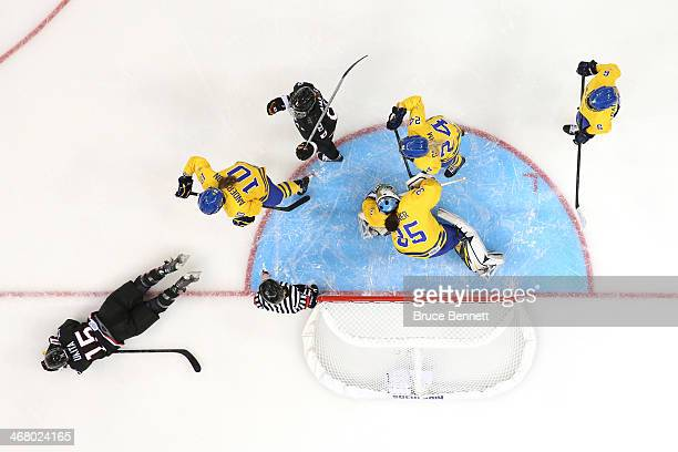 Valentina Wallner of Sweden saves the puck while Rui Ukita of Japan falls on the rink during the Women's Ice Hockey Preliminary Round Group B Game on...