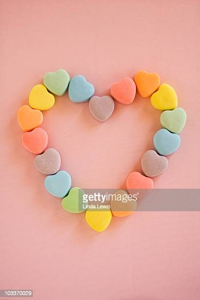 valentine candy hearts in a heart shape. - candy heart stock pictures, royalty-free photos & images