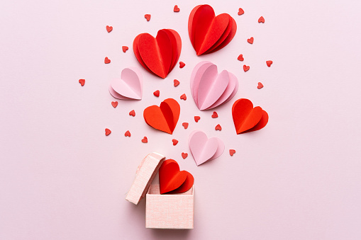 Valentine day composition with gift box and red hearts, photo template on pink background. 1186052506