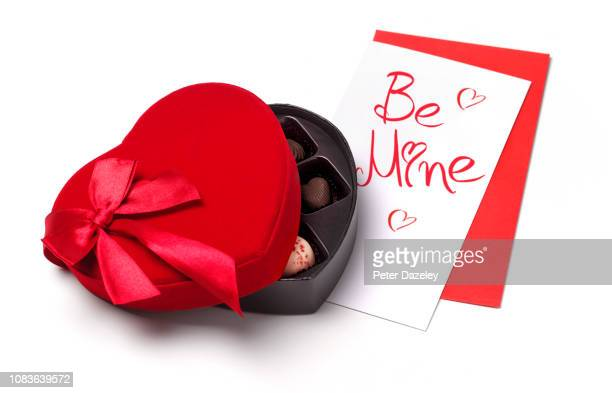 valentine days day surprise card and chocolates - chocolate pieces stock photos and pictures