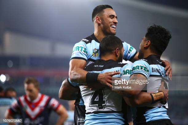 Valentine Holmes and Ricky Leutele of the Sharks celebrate with Sosaia Feki of the Sharks after he scored a try during the NRL Qualifying Final match...