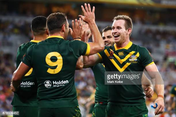 Valentine Holmes Cameron Smith Wade Graham and Michael Morgan of Australia celebrate Valentine Holmes scoring a try during the 2017 Rugby League...