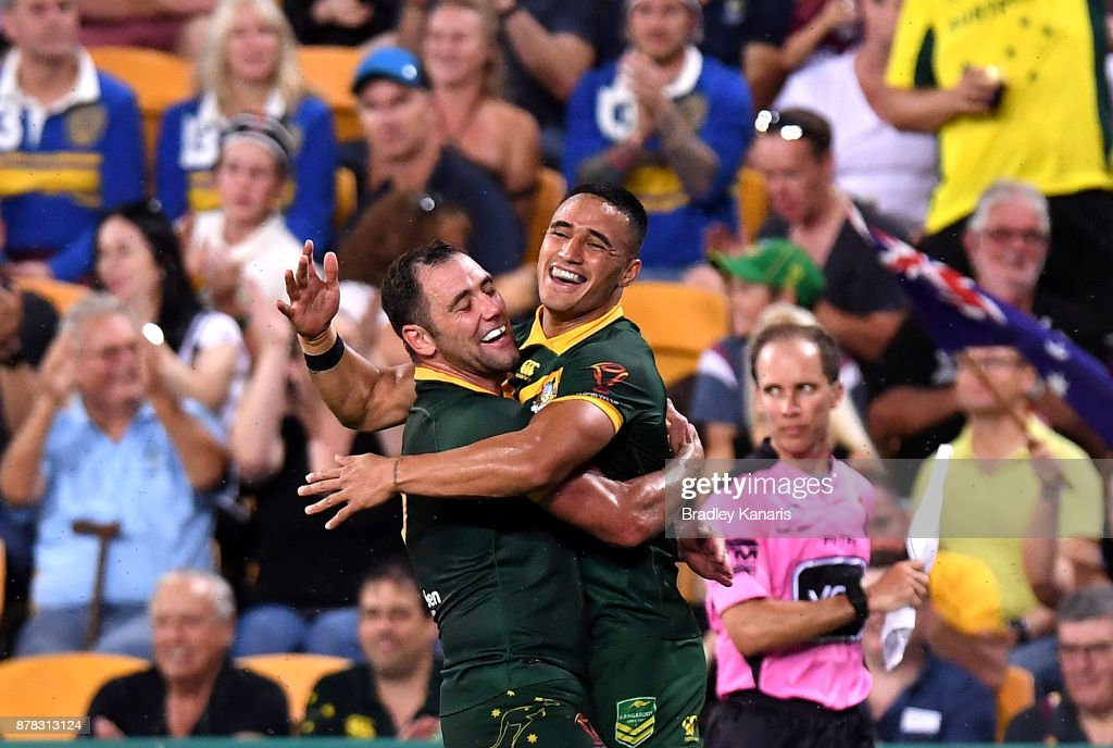 Valentine Holmes of Australia celebrates with team mate Cameron Smith after scoring a try during the 2017 Rugby League World Cup Semi Final match between the Australian Kangaroos and Fiji at Suncorp Stadium on November 24, 2017 in Brisbane, Australia.