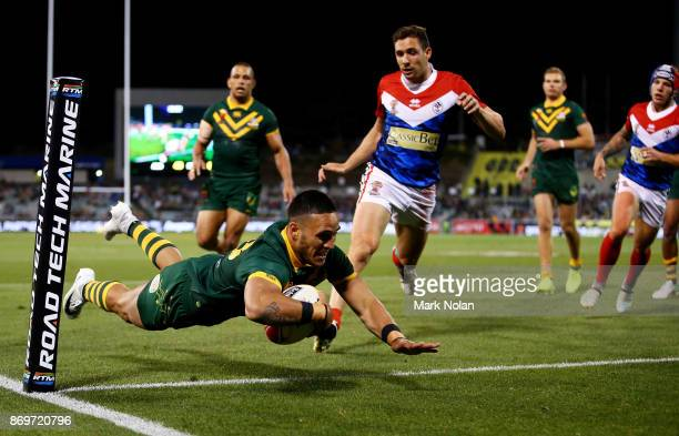 Valentine Holmes of Australia dives to score during the 2017 Rugby League World Cup match between Australian Kangaroos and France at Canberra Stadium...
