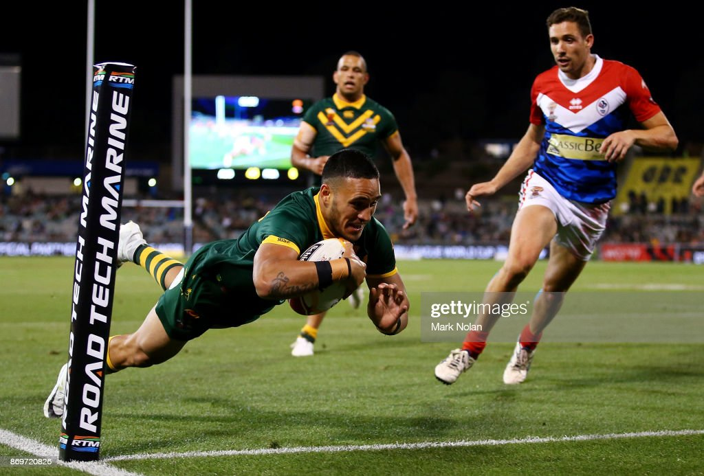 Valentine Holmes of Australia dives to score during the 2017 Rugby League World Cup match between Australian Kangaroos and France at Canberra Stadium on November 3, 2017 in Canberra, Australia.
