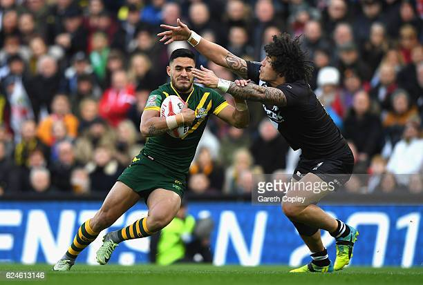 Valentine Holmes of Australia is tackled by Kevin Proctor of New Zealand during the Four Nations Final between New Zealand and Australia at Anfield...