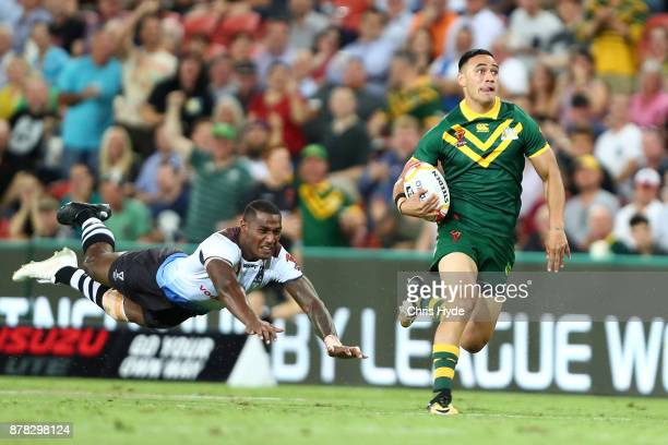 Valentine Holmes of Australia makes a break to score a try during the 2017 Rugby League World Cup Semi Final match between the Australian Kangaroos...