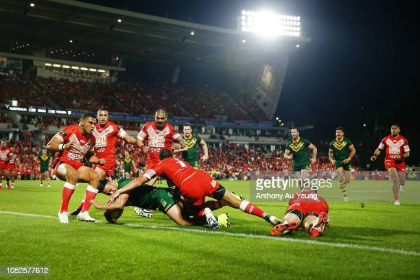 Valentine Holmes of Australia scores a try against William Hopoate of Tonga during the International Test match between Tonga and Australia at Mount...