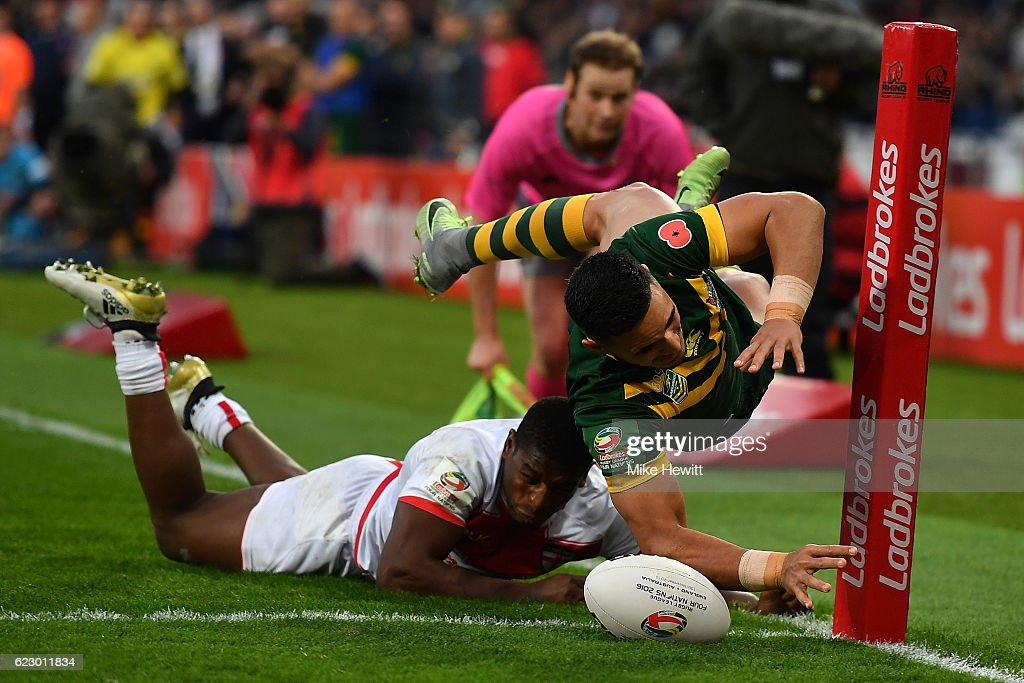 Valentine Holmes of Australia scores in the corner despite the efforts of Jermaine McGillvary of England during the Four Nations match between the England and Australian Kangaroos at Olympic Stadium on November 13, 2016 in London, United Kingdom.