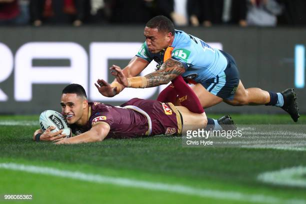 Valentine Holmes of Maroons scores a try during game three of the State of Origin series between the Queensland Maroons and the New South Wales Blues...