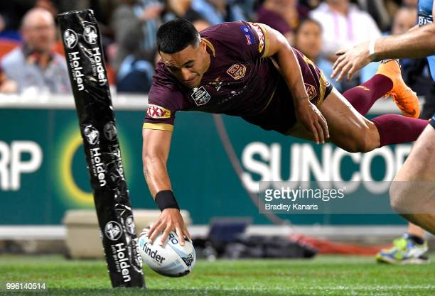 Valentine Holmes of Queensland scores a try during game three of the State of Origin series between the Queensland Maroons and the New South Wales...