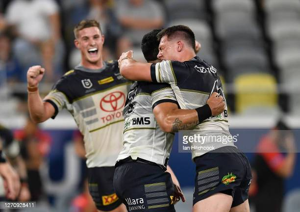 Valentine Holmes of the Cowboys celebrates after kicking the match winning field goal during the round 17 NRL match between the North Queensland...