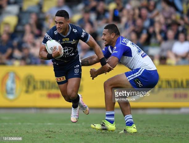 Valentine Holmes of the Cowboys skips out of a tackle by Ofahiki Ogden of the Bulldogs during the round six NRL match between the North Queensland...