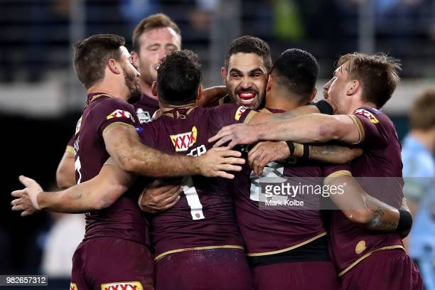 Valentine Holmes of the Maroons celebrates scoring a try with Greg Inglis of the Maroons during game two of the State of Origin series between the...