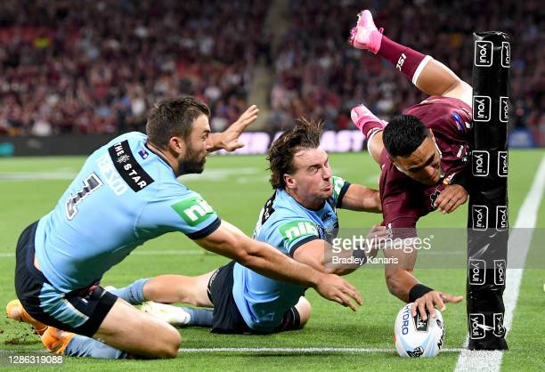 Valentine Holmes of the Maroons scores a try during game three of the State of Origin series between the Queensland Maroons and the New South Wales...