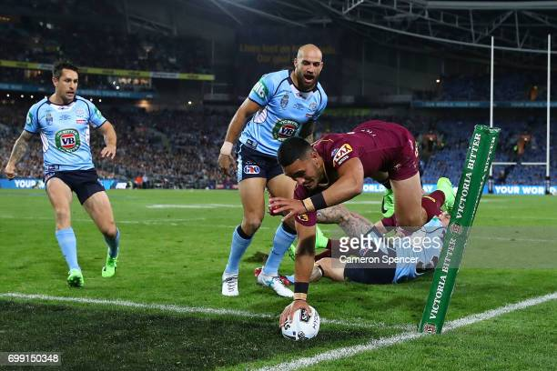 Valentine Holmes of the Maroons scores a try during game two of the State Of Origin series between the New South Wales Blues and the Queensland...