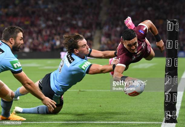 Valentine Holmes of the Maroons scores during game three of the State of Origin series between the Queensland Maroons and the New South Wales Blues...