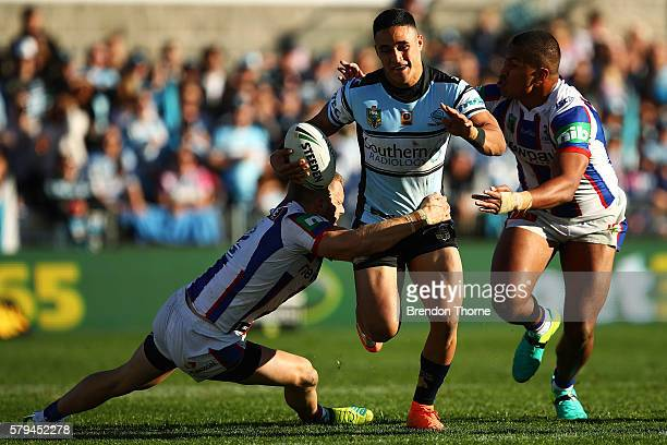 Valentine Holmes of the Sharks breaks the Knights defence during the round 20 NRL match between the Cronulla Sharks and the Newcastle Knights at...