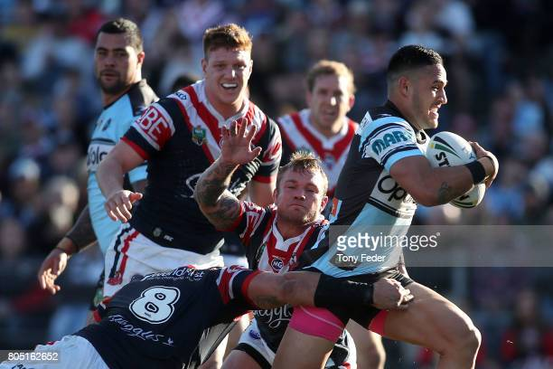 Valentine Holmes of the Sharks breaks through the Roosters defence to score a try during the round 17 NRL match between the Sydney Roosters and the...