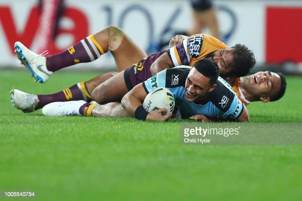 Valentine Holmes of the Sharks celebrates a try during the round 20 NRL match between the Brisbane Broncos and the Cronulla Sharks at Suncorp Stadium...