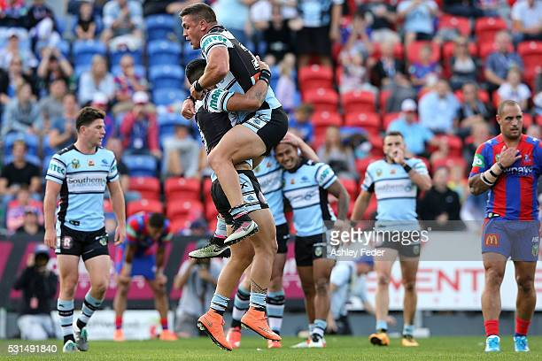 Valentine Holmes of the Sharks celebrates a try with team mates during the round 10 NRL match between the Newcastle Knights and the Cronulla Sharks...