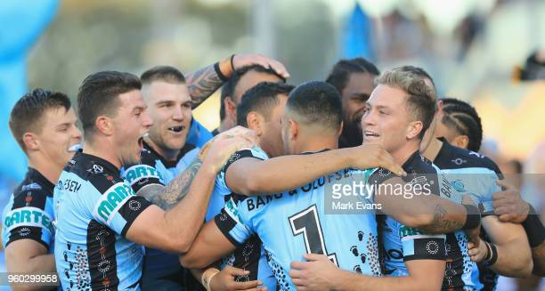 Valentine Holmes of the Sharks celebrates a try with team matesduring the round 11 NRL match between the Cronulla Sharks and the Canterbury Bulldogs...
