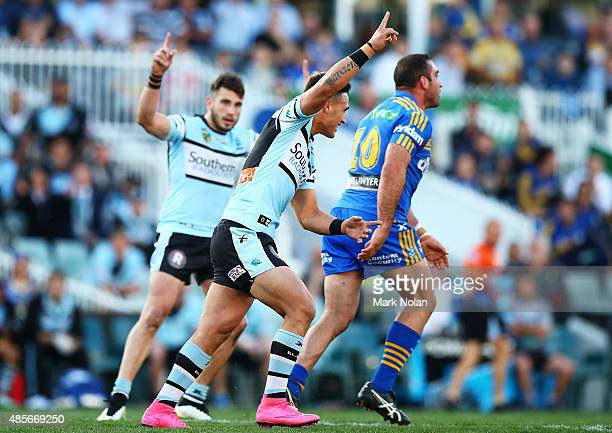 Valentine Holmes of the Sharks celebrates kicking a field goal during the round 25 NRL match between the Parramatta Eels and the Cronulla Sharks at...