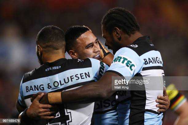 Valentine Holmes of the Sharks celebrates with team mates after scoring a try during the round 18 NRL match between the Panthers and the Sharks at...