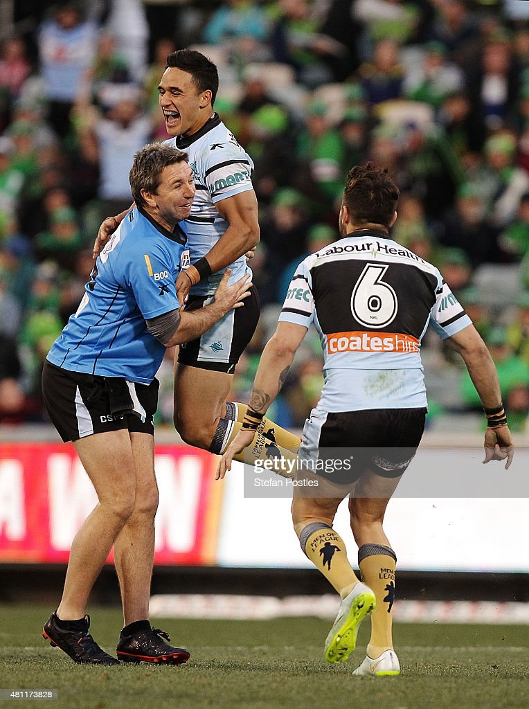 Valentine Holmes of the Sharks celebrates with trainer Steve Price after scoring the winning field goal during the round 19 NRL match between the Canberra Raiders and the Cronulla Sharks at GIO Stadium on July 18, 2015 in Canberra, Australia.