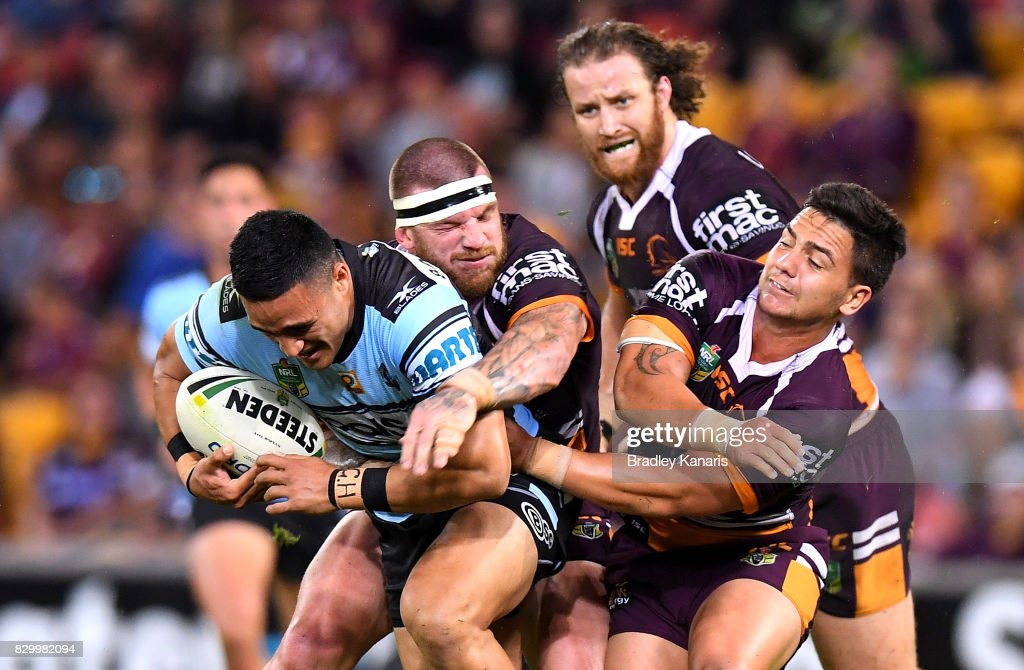 Valentine Holmes of the Sharks is caught by the defence during the round 23 NRL match between the Brisbane Broncos and the Cronulla Sharks at Suncorp Stadium on August 11, 2017 in Brisbane, Australia.