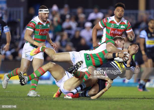 Valentine Holmes of the Sharks is tackled by George Burgess of the Rabbitohs during the round 20 NRL match between the Cronulla Sharks and the South...