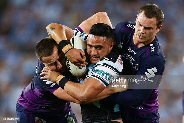 Valentine Holmes of the Sharks is tackled during the 2016 NRL Grand Final match between the Cronulla Sharks and the Melbourne Storm at ANZ Stadium on...