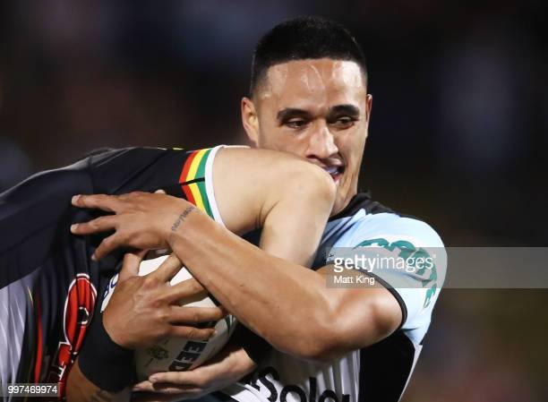 Valentine Holmes of the Sharks is tackled during the round 18 NRL match between the Panthers and the Sharks at Panthers Stadium on July 13 2018 in...