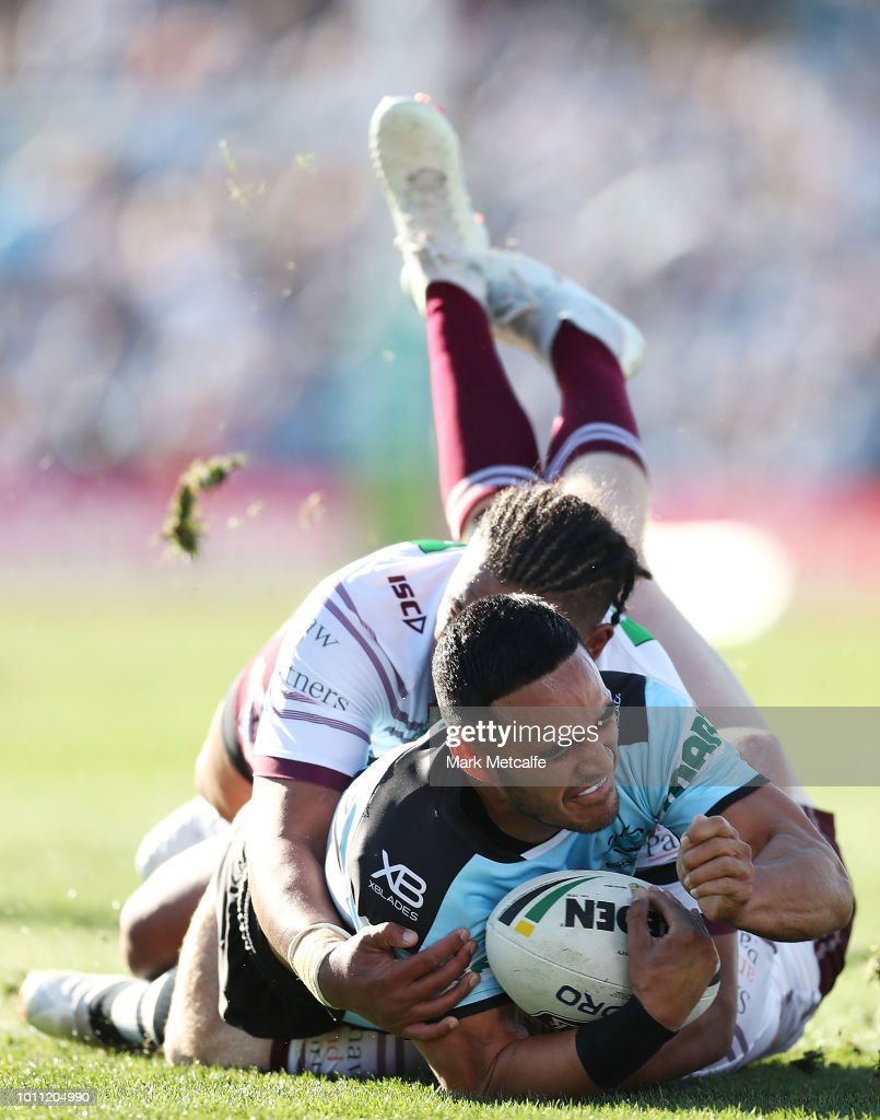 Valentine Holmes of the Sharks is tackled during the round 21 NRL match between the Cronulla Sharks and the Manly Sea Eagles at Southern Cross Group Stadium on August 5, 2018 in Sydney, Australia.