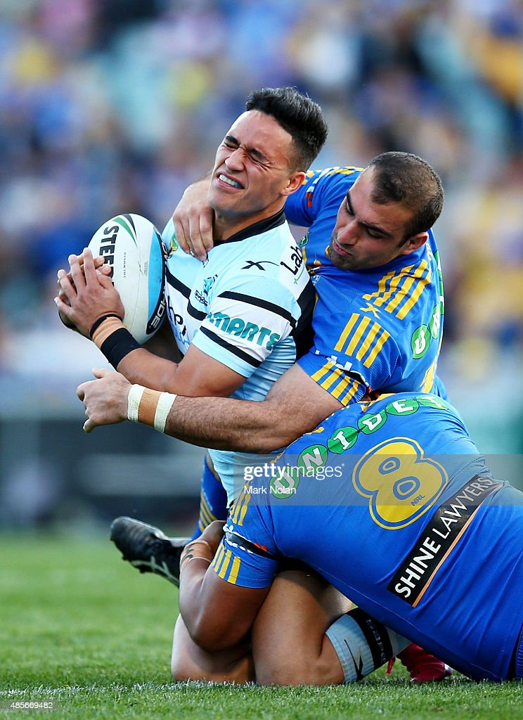 Valentine Holmes of the Sharks is tackled during the round 25 NRL match between the Parramatta Eels and the Cronulla Sharks at Pirtek Stadium on August 29, 2015 in Sydney, Australia.