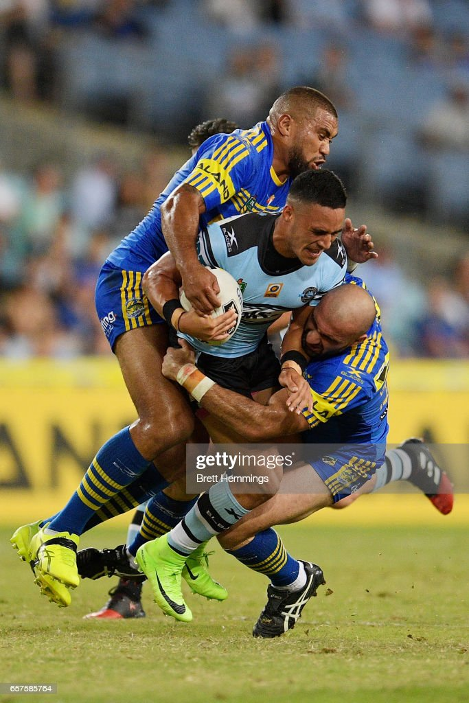 Valentine Holmes of the Sharks is tackled during the round four NRL match between the Parramatta Eels and the Cronulla Sharks at ANZ Stadium on March 25, 2017 in Sydney, Australia.