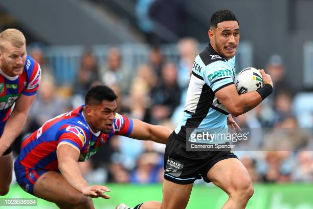Valentine Holmes of the Sharks makes a break during the round 24 NRL match between the Cronulla Sharks and the Newcastle Knights at Southern Cross...