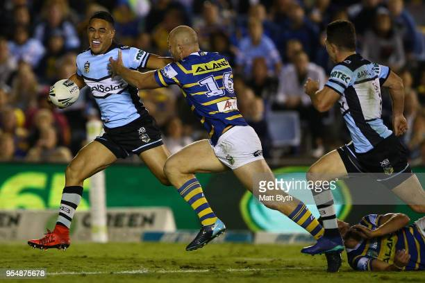 Valentine Holmes of the Sharks makes a break during the round nine NRL match between the Cronulla Sharks and the Parramatta Eels at Southern Cross...