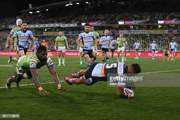 Valentine Holmes of the Sharks scores a try during the NRL Qualifying Final match between the Canberra Raiders and the Cronulla Sharks at GIO Stadium...