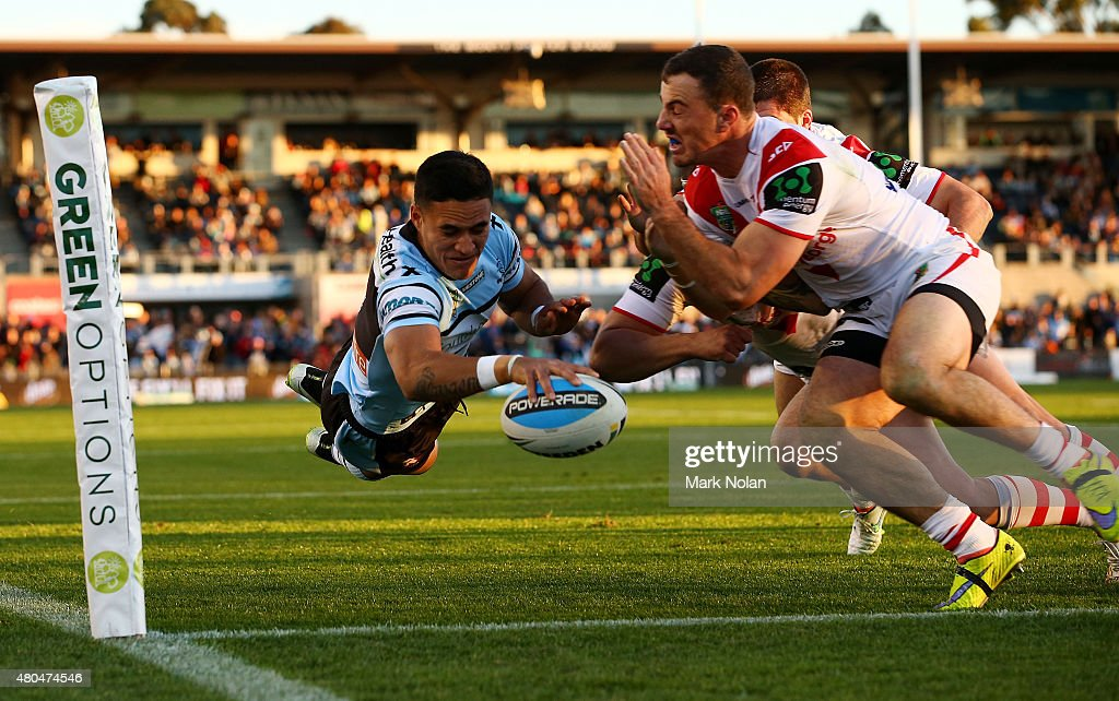 Valentine Holmes of the Sharks scores a try during the round 18 NRL match between the Cronulla Sharks and the St George Illawarra Dragons at Remondis Stadium on July 12, 2015 in Sydney, Australia.