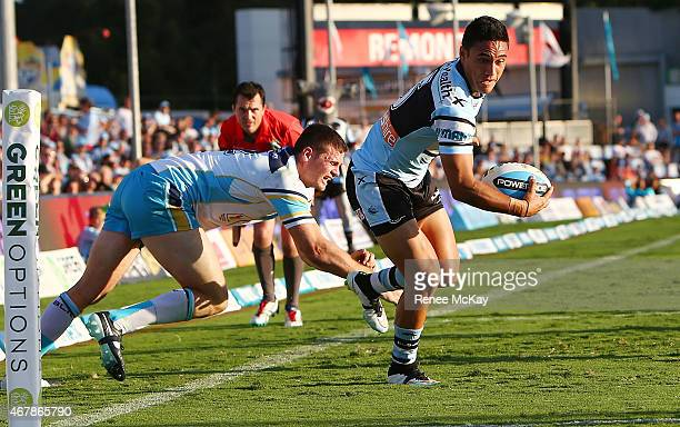 Valentine Holmes of the Sharks scores a try during the round four NRL match between the Cronulla Sharks and the Gold Coast Titans at Remondis Stadium...