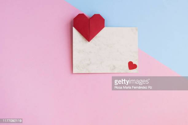 valentine letter: blank with origami heart shape ready for love message on pastel colored background. directly above and copy space - pink and blue background stock pictures, royalty-free photos & images