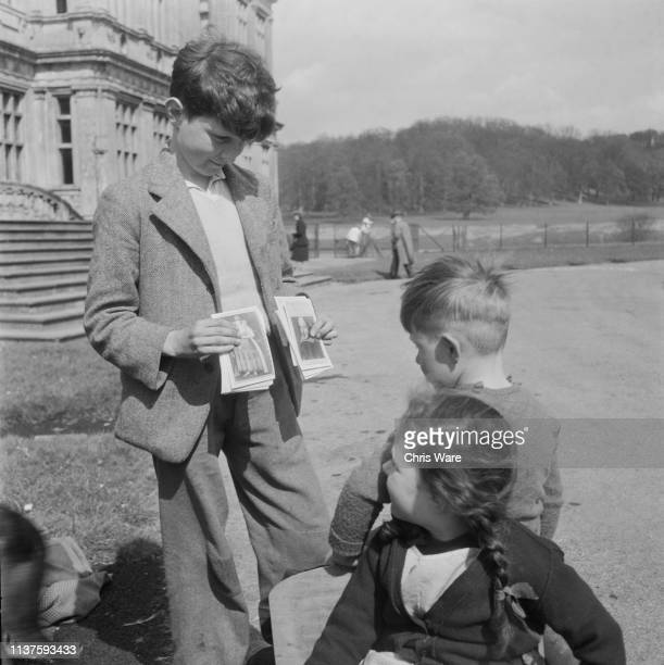 Valentine Thynne son of the 6th Marquess of Bath sells postcard reproductions of paintings in his father's collection to young visitors to his family...