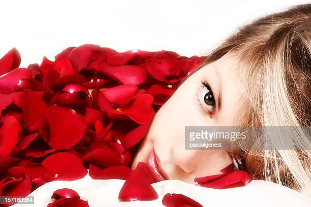 valentine's blond girl portrait in roses petals - wishful skin stock pictures, royalty-free photos & images